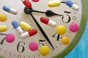 Variety of sleeping pills on clock face